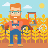 Man standing with combine on background. Stock Photography