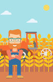 Man standing with combine on background. Royalty Free Stock Photos