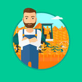 Man standing with combine on background. A hipster man with the beard standing in wheat field and a combine working on a background. Vector flat design Stock Photo