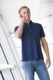 Man standing in corridor wearing headset smiling stock image