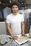 Man Standing At Counter In Dry Cleaning Store Royalty Free Stock Photography