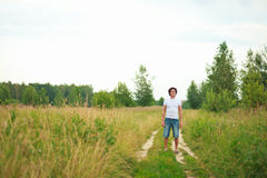 A man standing on a country road Stock Image