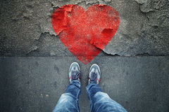Man standing on cracked floor with heart symbol Royalty Free Stock Photography
