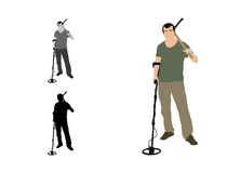 Man standing with a detector and a pickaxe on his shoulder. Front view of a man looking at camera standing with a detector and a pickaxe on his shoulder Royalty Free Stock Photography