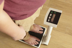 Man standing on digital scales cropped waist down Stock Photo