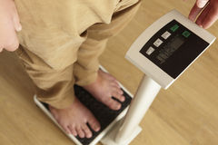 Man standing on digital scales cropped waist down Royalty Free Stock Images