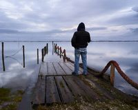 Man standing at the dock stock photo
