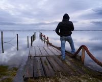 Man standing at the dock on a winter day royalty free stock photo
