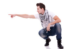 Man standing down pointing to his side Royalty Free Stock Photo