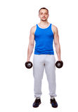 Man standing with dumbbells Royalty Free Stock Image