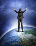 Man standing on the Earth planet. Royalty Free Stock Photography