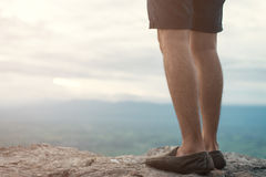 Man standing on edge of cliff mountain top , travel concept. Stock Photo