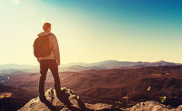 Man standing at the edge of a cliff. Overlooking the mountains below Royalty Free Stock Photography
