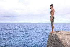 Man standing on the edge Stock Images