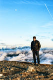 Man standing at the edge of a peak Royalty Free Stock Photography