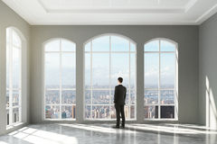 Man standing in an empty loft interior and looking in window. Close up Stock Photo