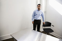 Man standing in empty office Royalty Free Stock Photo