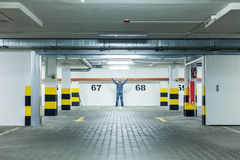 Man Standing at Empty parking lot Royalty Free Stock Image