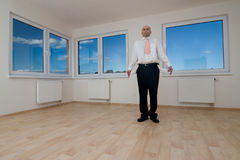 Man standing in empty room Stock Images