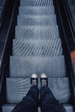 Man Standing at Escalator Stock Image