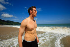 Man standing on exotic beach Stock Photo