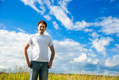Man standing in a field Royalty Free Stock Photo