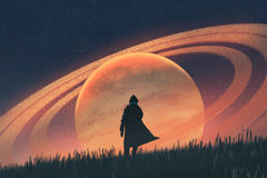 Man standing on field against the planet. Night scene of the man standing on field against the planet with rings, illustration painting Royalty Free Stock Photos