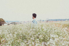 Man Standing on Field Against Sky Royalty Free Stock Photo