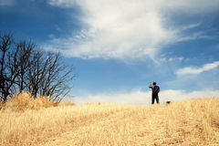 Man standing in a field Royalty Free Stock Image
