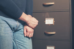Man standing by file cabinet Royalty Free Stock Photo