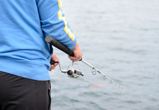 Man standing fishing at the seaside Royalty Free Stock Images