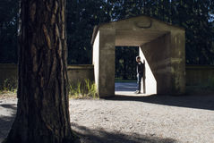 Man standing in flooding sunlight in a stone vault. Stock Image