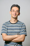 Man standing with folded hands Stock Image