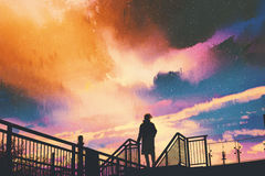 Man standing on footbridge against colorful sky. Silhouette of man standing on footbridge against colorful sky, illustration painting Stock Photography