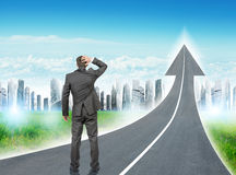Man standing on freeway going up as arrow Stock Photos