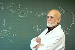 Man standing in front of a blackboard. Professor stands in front of a blackboard and hears a student to Royalty Free Stock Photography
