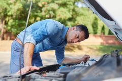 Man standing in front of a broken car royalty free stock photos