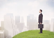 Man standing in front of city landscape Stock Image