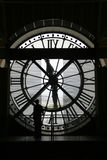 Man standing in front of clock. Man standing in front of a clock in Museé D'Orsay, Paris Stock Photo