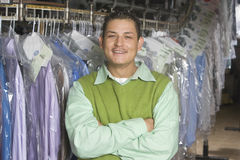 Man Standing In Front Of Clothes Rail Royalty Free Stock Images