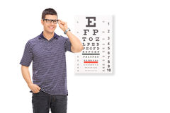 Man standing in front of an eye chart Stock Photo