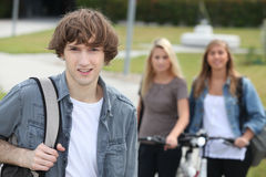 Man standing in front of girls Stock Photography