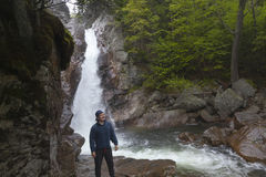 Man Standing in front of Glen Ellis Falls on the Ellis River Pin. Man Standing in front of Glen Ellis Falls at Pinkham Notch in New Hampshire Stock Photos