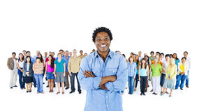 Man Standing front of the Group of People Stock Photos