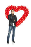 Man standing in front of heart shape Royalty Free Stock Photography