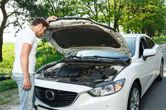 Man standing in front of opened bonnet Stock Images