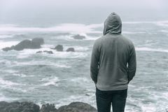 Man standing in front of the pacific ocean royalty free stock photo