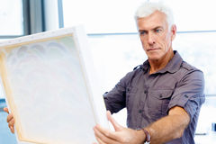 Man standing in a gallery and contemplating. Abstract artwork Stock Image