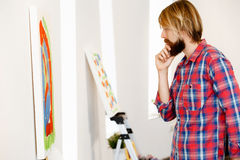 Man standing in a gallery and contemplating. Abstract artwork Royalty Free Stock Photo