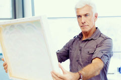Man standing in a gallery and contemplating. Abstract artwork Stock Photos